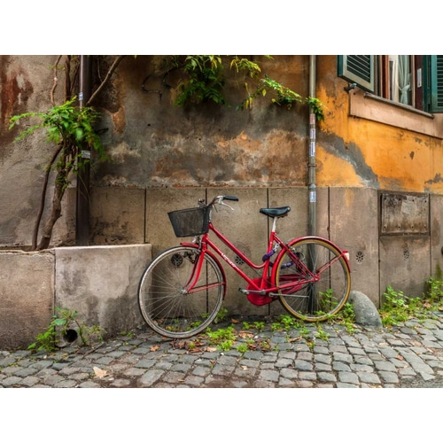 Bicycle outside old building, Rome, Italy
