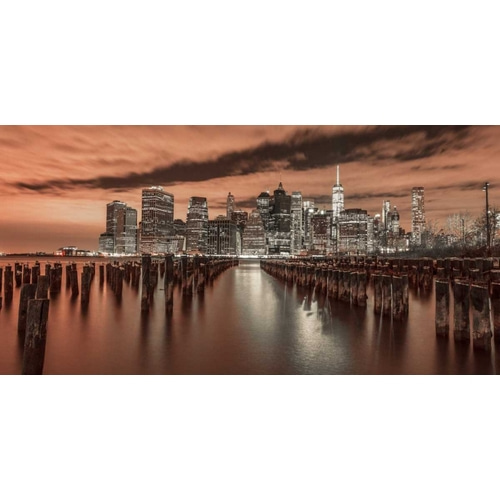 Manhattan skyline with rows of groynes in foreground, New York